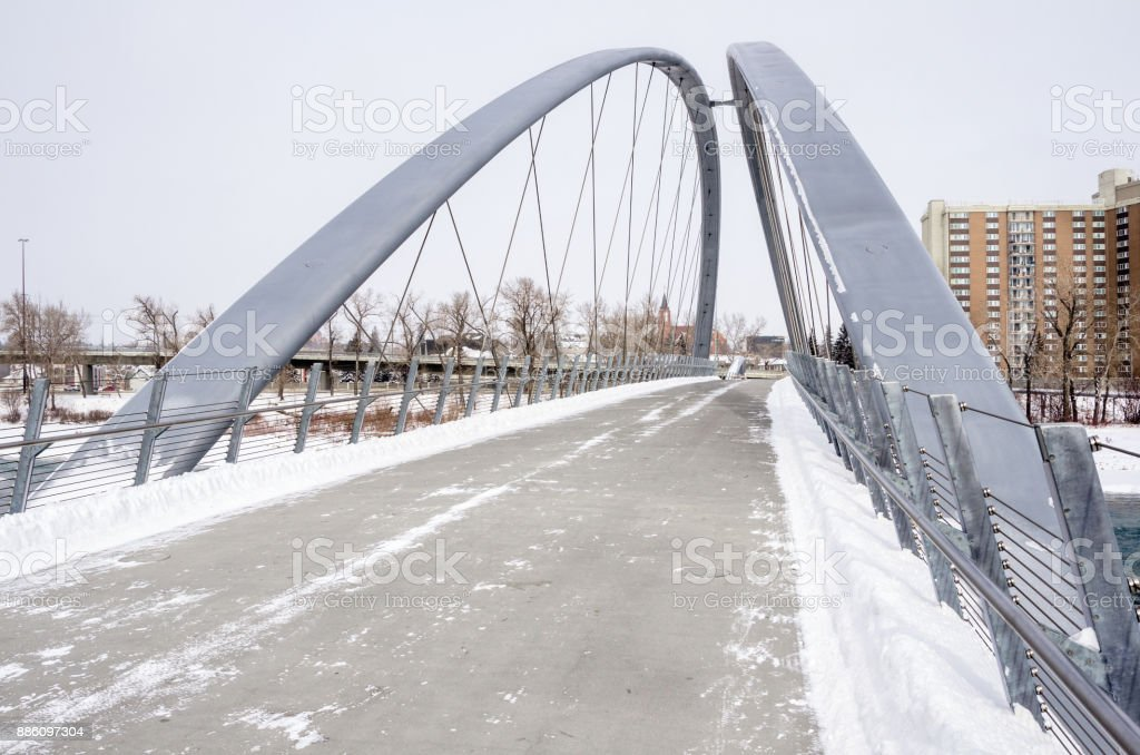 Deserted Pedestrian Bridge Cleared of Snow on a Winter Day stock photo