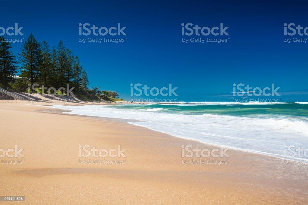 Deserted section of Dicky Beach on a sunny day, Caloundra, Australia stock photo