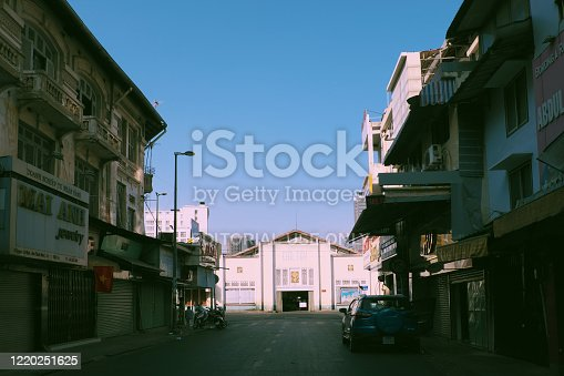istock deserted street, silent scene at  big city effect by request limit move around in pandemic, Ben Thanh market, Vietnam 1220251625