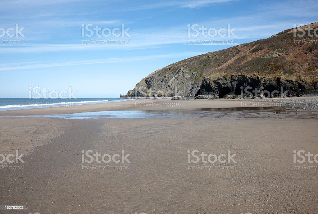 Deserted Welsh sandy beach deep blue sky royalty-free stock photo