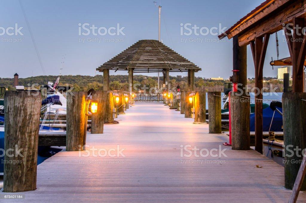Deserted Wooden Pier at Dusk stock photo