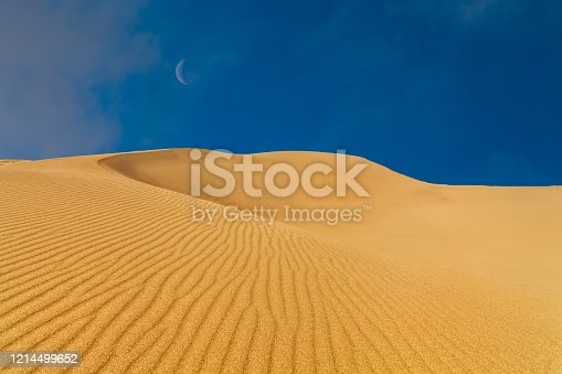 Sunset at sand dune in desert beautiful sky