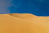 Deserts and Sand Dunes Landscape at Sunrise.