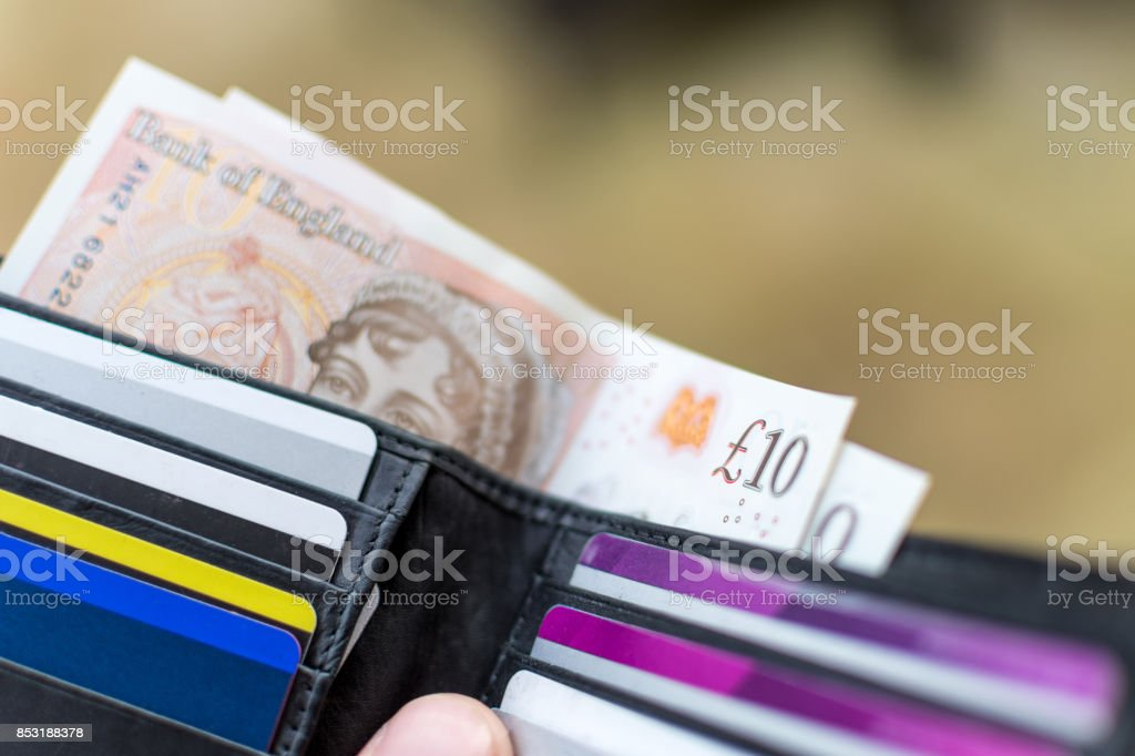 2017 design £10 note - UK Currency in a wallet stock photo