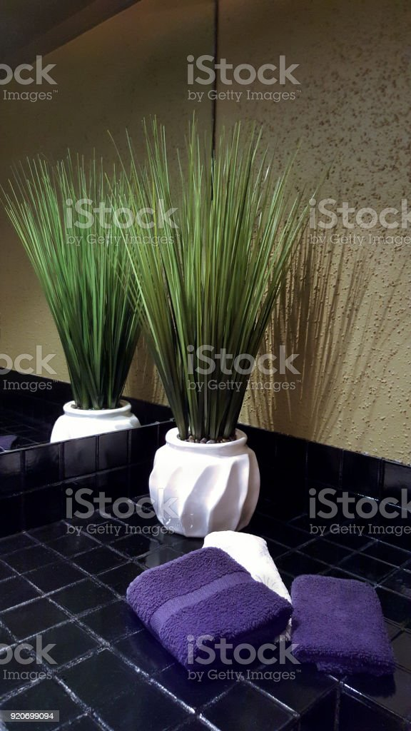 Design Accents And Mirror Reflection In Residential Bathroom stock photo
