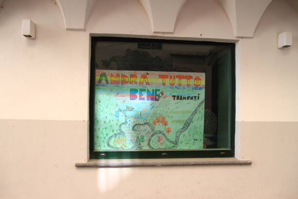 Design against the covid-19 displayed in the window Minori,Sa,Italy - may 21,2020 :A sign with the words