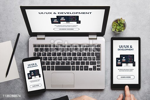 995213208 istock photo UI/UX design and development concept on laptop, tablet and smartphone screen 1135286574