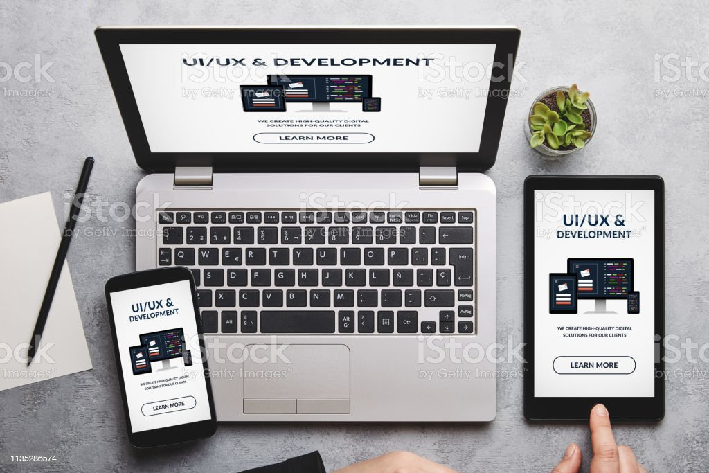 UI/UX design and development concept on laptop, tablet and smartphone screen stock photo