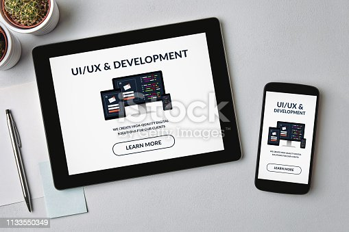 1134879628 istock photo UI/UX design and development concept on tablet and smartphone screen 1133550349