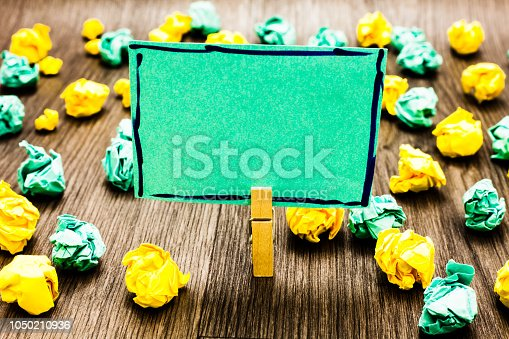 istock Design business concept Business ad for website promotion banners empty social media ad Clothespin holding green note paper crumpled papers several tries mistakes 1050210936