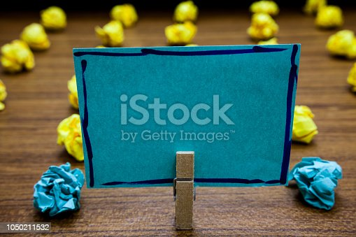 istock Design business concept Business ad for website promotion banners empty social media ad Blurry wooden deck yellow and blue lob on ground paper clip grip page with text 1050211532