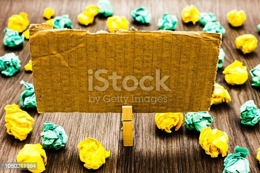 istock Design business concept Business ad for website promotion banners empty social media ad Paperclip grip cardboard with texts analysisy colorful lobs scattered on wooden desk 1050211994