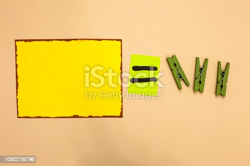 istock Design business concept Business ad for website promotion banners empty social media ad Yellow piece paper reminder equal sign several clothespins sending message 1050216796