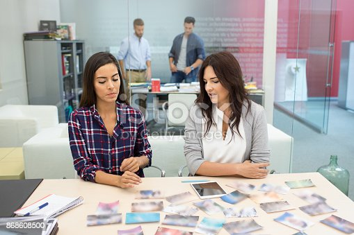 istock Design colleagues choosing for a project 868608500