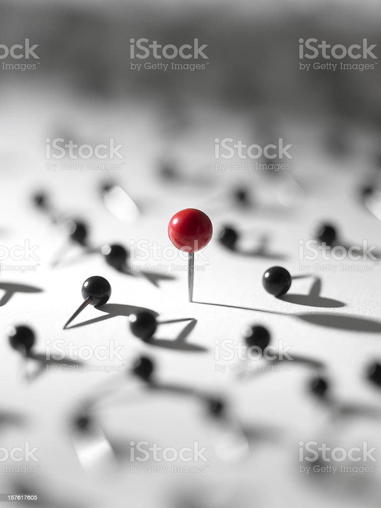 Design concept for standing out from the crown with pins stock photo