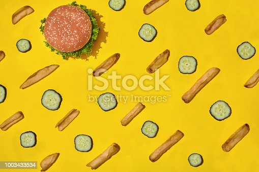 1156991909 istock photo Design concept of mockup burger and french fries set on yellow background 1003433534