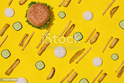 1156991909 istock photo Design concept of mockup burger and french fries set on yellow background 1003444964