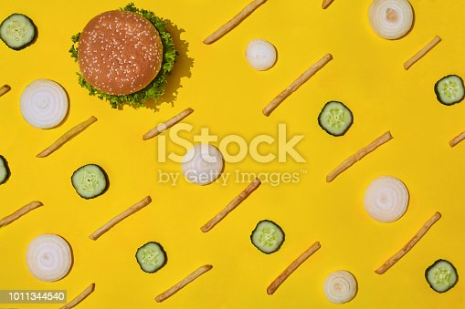 1156991909 istock photo Design concept of mockup burger and french fries set on yellow background 1011344540