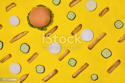 1156991909 istock photo Design concept of mockup burger and french fries set on yellow background 1011349680