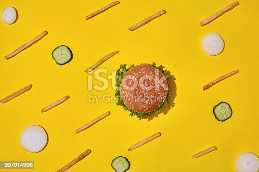 1156991909 istock photo Design concept of mockup burger and french fries set on yellow background 997014996