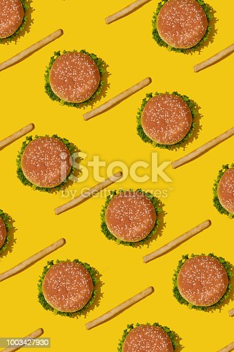 1156991909 istock photo Design concept of mockup burgers and french fries set on yellow background 1003427930