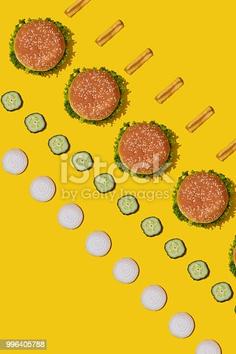 1156991909 istock photo Design concept of mockup burgers and french fries set on yellow background 996405788