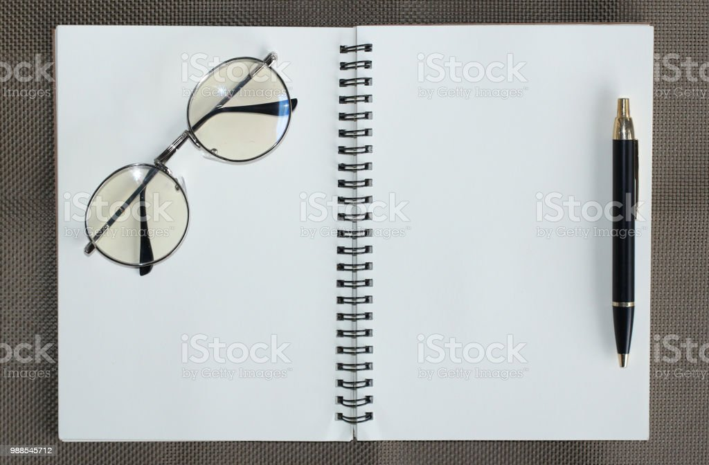 Design concept - Top view of hardcover kraft notebook and ballpoint...