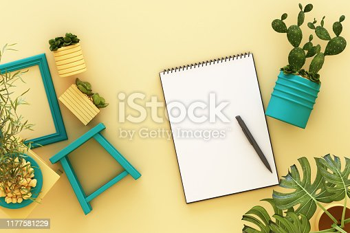 istock Design concept - top view of white A4 flipped paper with black clipboard, potted plant, cactus, frame and pen on pastel yellow background. 3d rendering 1177581229