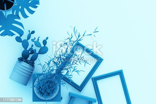 istock Design concept - top view of white A4 flipped paper with black clipboard, potted plant, cactus, frame and pen on blue background. 3d rendering 1177581236