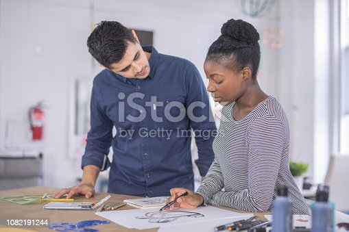 istock Design couple strategize in their modern studio 1082191244