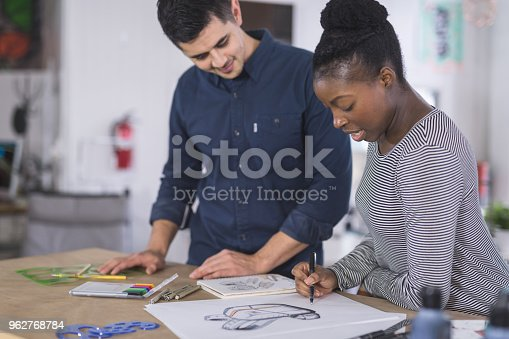istock Design couple strategize in their modern studio 962768784