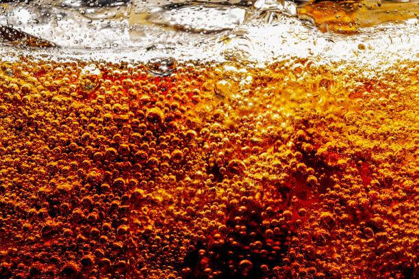 ontwerpelement. bier bellen macro, cola close-up - cola stockfoto's en -beelden