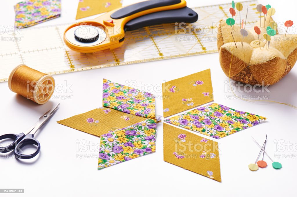 Design  element of  quilt in progress, prepared cut pieces and sew one around accessories, patchwork stock photo