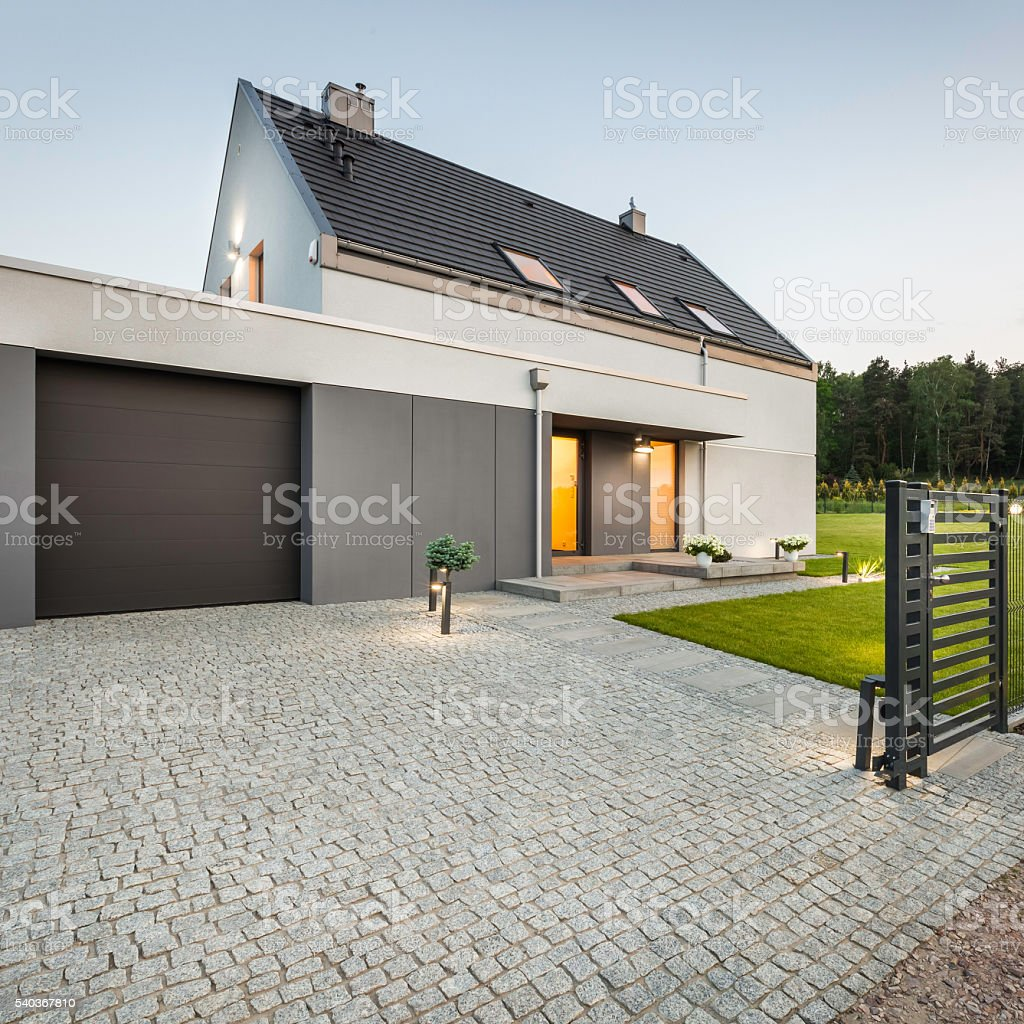 Design house with stone driveway stock photo