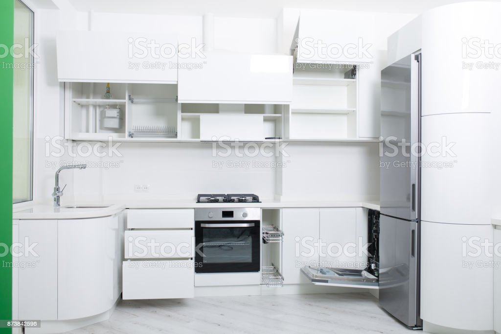 Design of a new light kitchen in pastel colors. Cabinets are open stock photo
