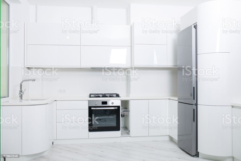 Design of a new light kitchen in pastel colors. stock photo