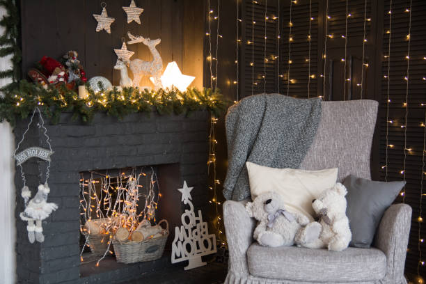 Design of Christmas interior with fireplace and an armchair stock photo