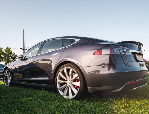 Design of modern electric car outdoors Tesla Motors STRASBOURG, FRANCE - SEP 3, 2017: Side view of shiny modern Tesla Model S electric car with elegant design in dark gray color outdoors tesla model s stock pictures, royalty-free photos & images