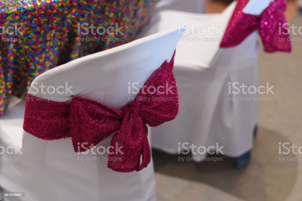 Design Of Red Bow Decorated On Chairs At Chinese Table Dinner For