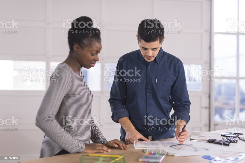 Design partners strategize in their modern studio - Foto stock royalty-free di Adulto