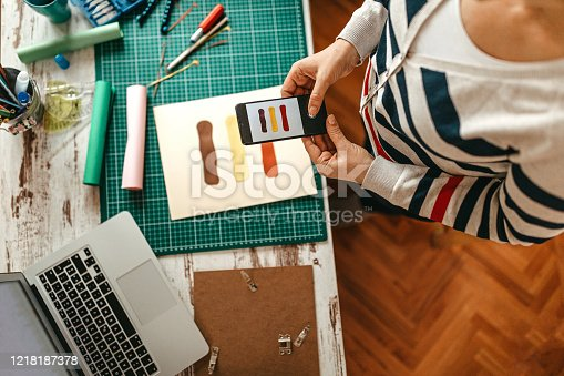 923634538 istock photo Design professional photographing color sample on work desk 1218187378