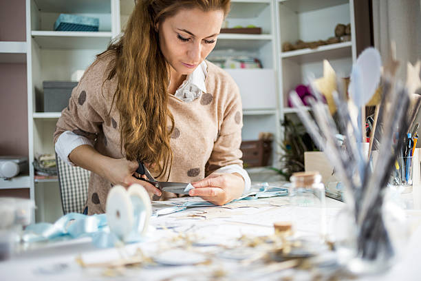 Design professional Artisan woman cutting paper in her atelier, small business owner hobbies stock pictures, royalty-free photos & images