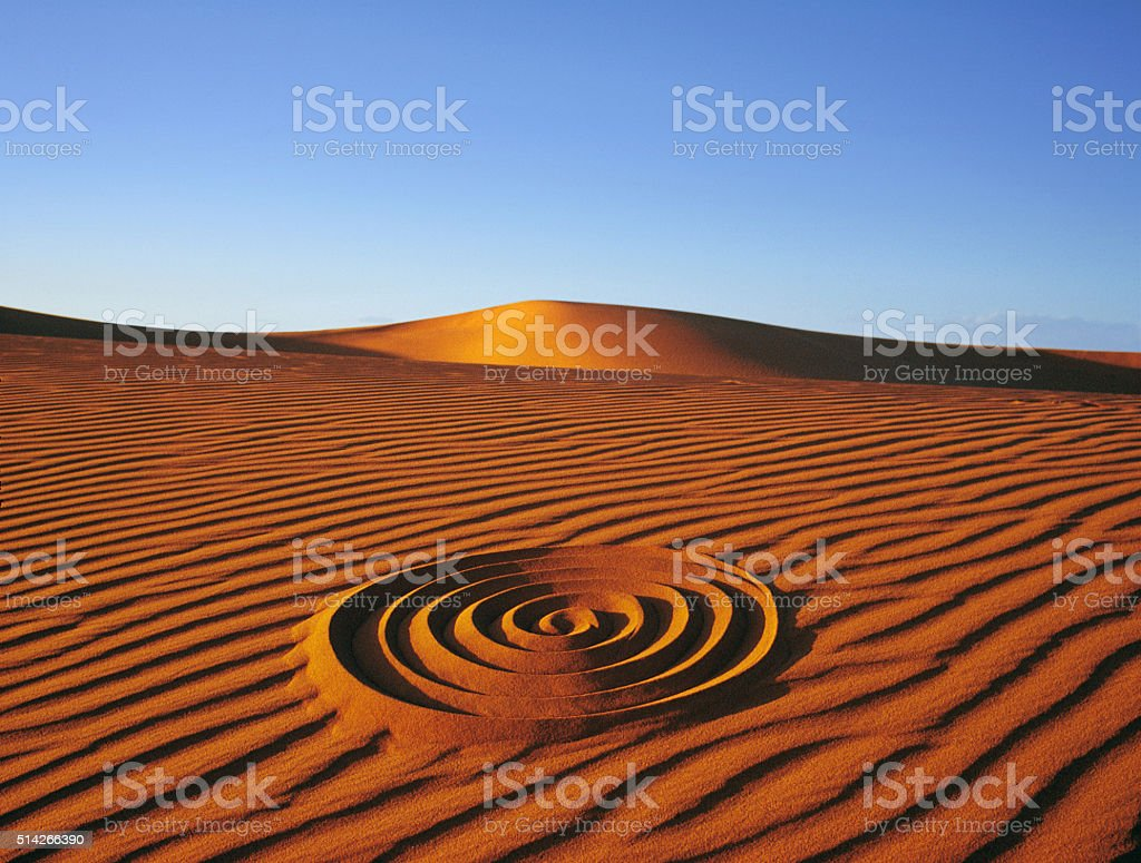 Design spiral in the desert stock photo