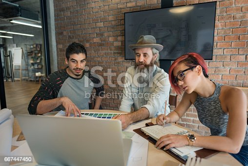 istock Design Studio Architect Creative Occupation Meeting Blueprint Concept 667447450