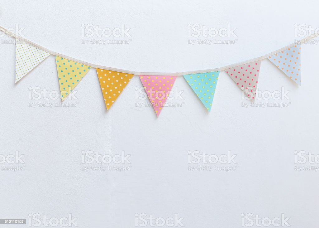 Design vintage fabric party flag over white cement wall texture background - fotografia de stock