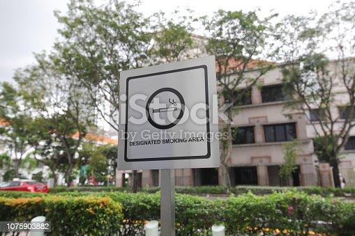 Designated smoking area sign in Singapore.