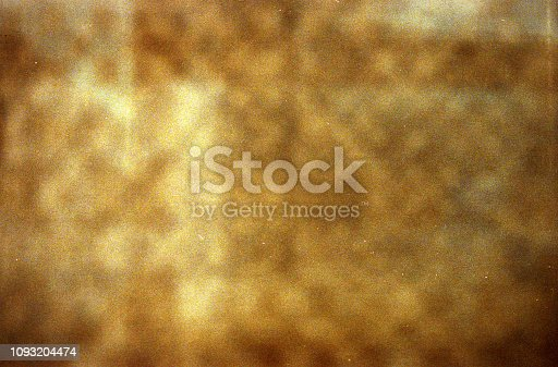 1131841696 istock photo Designed golden grainy film background 1093204474