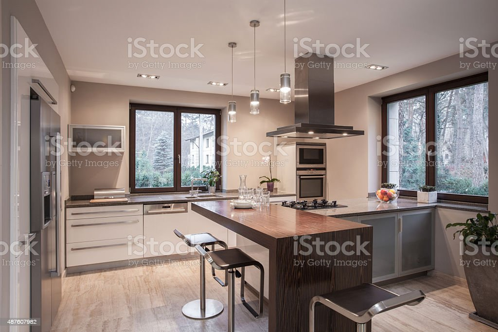 Designed kitchen in modern house stock photo