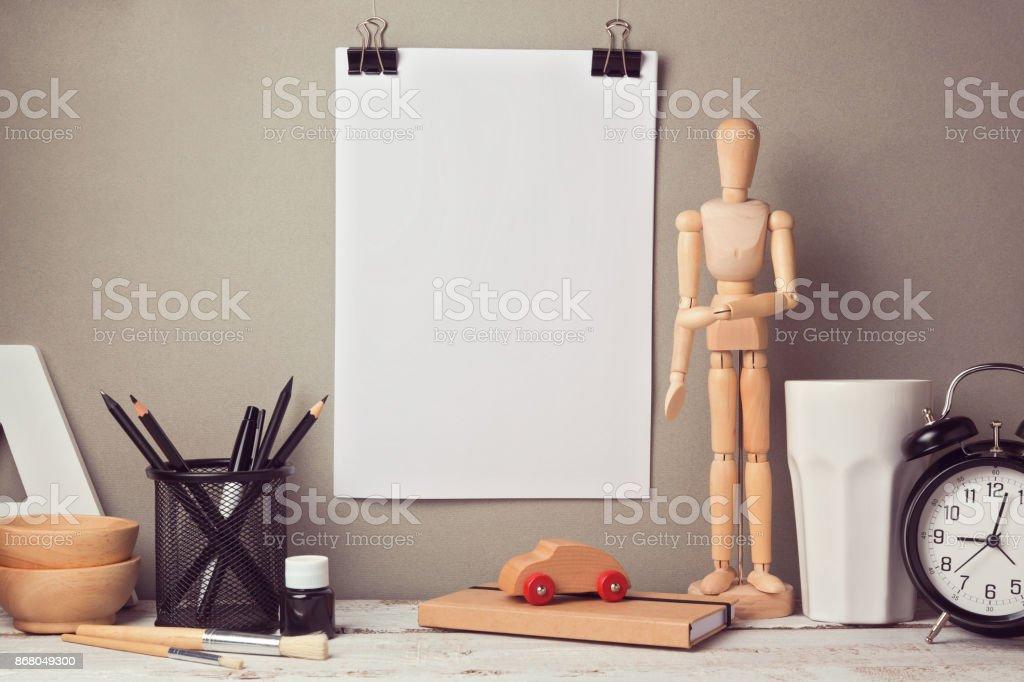 Designer artistic desk website header hero image with blank poster mock up stock photo