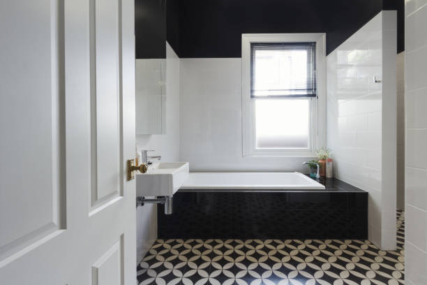 designer bathroom renovation with black and white floor tiles horizontal - bathroom renovation stock photos and pictures
